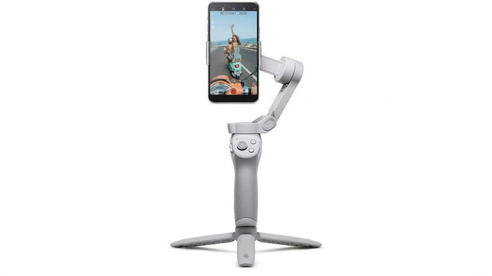 DJI OM4 smart stabilised gimbal with iPhone tripod attachment